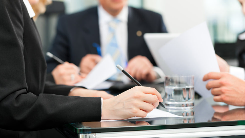 Business - meeting in an office, lawyers or attorneys discussing a document or contract agreement